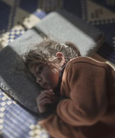 Syrian Refugee Children Where Do They Sleep | Swedish photographer Magnus Wennman captures where Syrian refugee children are forced to lay their heads each night as they flee violence. #refinery29 http://www.refinery29.com/2015/11/97460/where-syrian-refugee-children-sleep