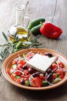 GREECE - Greek salad: a mixture of olives, feta, tomato, onion, cucumber, pepper and olive oil.   photo: Van Zai