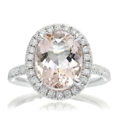 A beautiful design engagement ring featuring a peachy pink Morganite adorned with dazzling white diamonds. This setting is available in18k, rose gold, white gold, yellow gold and platinum. A matching band is available to either sit with a gap (straight matching band) or a curved band to sit fl