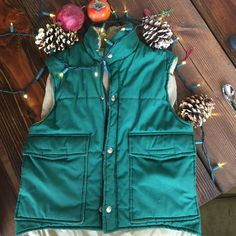 Super warm hipster camping vest -vintage- This vintage vest is perfect for your next camping trip! So warm! Thick material reminds me of a sleeping bag, which sounds unflattering but the color, gorgeous nature green makes up for it! Durable and in great condition! Size on tag says xxs but it fit over a sweatshirt with room and I'm normally a small. (Some wear on zipper pull as pictured) Twin Peaks Jackets & Coats Vests