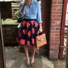 chambray shirt tucked into patterned full skirt