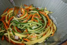 Vegetable salad: Wash the vegetables, then dry. Use a julienne peeler to form noodle shapes from the zucchini, squash, and carrot. Peel the entire vegetables. Steam the noodles. Once cooked, place the noodles in a bowl and top with freshly grated Parmesan cheese and some lemon juice.