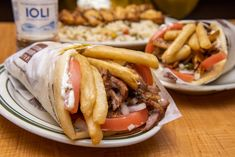 The best souvlaki and Gyros in Toronto represent Greek food at its finest, typically signified by tin foil, styrofoam and lots of eating with your . Beef Gyro, Best Restaurants In Toronto, Greek Restaurants, Fidel Gastro, Best Korean Bbq, Greek Fries, Budapest Restaurant, Kitchens