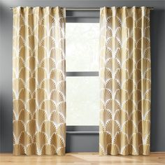 Shop stella curtain panel.   Deco pattern glams up 100% cotton in gleaming gold metallic print.  Panel allows light in and still provides moderate privacy.  Hang by standard rod pocket design or try the back tabs to create a more custom/ pleated effect.