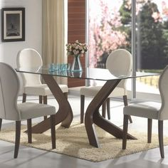 rectangle Glass Dining Table with dark brown wooden bases on the rug added by four white dining chairs