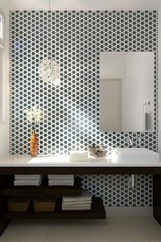Contemporary Full Bathroom with limestone tile floors, Corian counters, Crema Vosscione Limestone, Penny Tile, Vessel sink