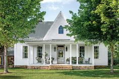 """Charming Tennessee Mountain Cottage ; The Exterior The """"window"""" that underscores this house's Gothic charm is actually a repurposed mirror found at an antiques shop in Nashville. A chipped Victorian front door sets the tone for the decor inside.  PHOTO: LAUREY W. GLENN"""