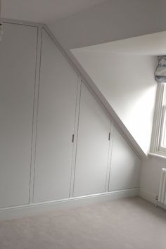 We created this bespoke fitted furniture under the eaves in the attic room of a beautiful Victorian home in London. Designed to maximise storage space and built to last. Contact us to discuss your new fitted furniture. Attic Bedroom Storage, Bedroom Built In Wardrobe, Attic Master Bedroom, Fitted Bedroom Furniture, Attic Bedroom Designs, Cupboard Wardrobe, Loft Storage, Fitted Bedrooms, Attic Wardrobe