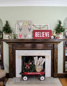 A holiday mantel is filled with thrift store finds and DIY art. Get the tutorial for the fun reindeer specimen!