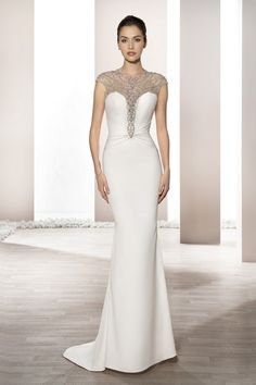 Luxurious Crepe and shimmering beaded detailing over sheer illusion on the Bateau neckline create this glamorous sleeveless sheath gown with a dramatic keyhole back and draped Sweep train finished with beaded broach. Style 698 by Top Wedding Dress Designers, Wedding Dresses For Sale, Wedding Bridesmaid Dresses, Bridal Dresses, Gown Wedding, Collection 2017, Bridal Collection, Essense Of Australia, Wedding Dress Pictures