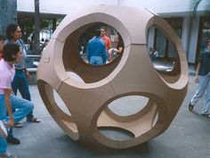 Geodesic cardboard structure held together by the springy tension of its materials.