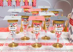 Dress up plain party flutes for the perfect graduation favors! We embellished ours with scrapbook paper and tassels for the cap, washi tape for the brim, labels for the date, and a little spray paint on the flute.