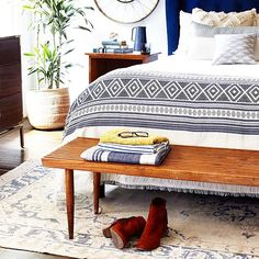 Beautiful bedroom by Paige Morse. Paired blanket from @luna_zorro and gorgeous faded rug from @kayakilims