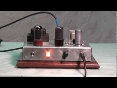 In this Part 2 video, a Fender Champ chassis is built from scrap parts, primarily from an early Premier RF Signal Generator, and is tested for its tone a. Diy Guitar Amp, Cool Tones, Scrap, Man Cave, Guitars, Cabinets, Audio, Tools, Electronics