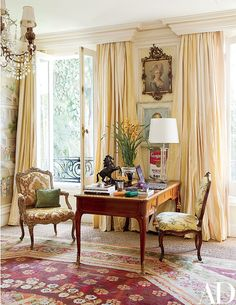 A Restoration Hardware lamp is paired with an 18th-century bureau plat in the master bedroom.