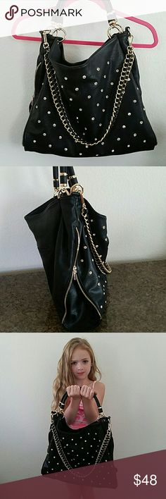Beautiful black purse w rhinestones! This purse is in great condition, ive used it once! It comes with a longer strap. And the gold chain strap is removable to use as a hand bag! Bags