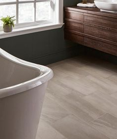 Give your home a fresh new look with our bathroom tiles. Discover contemporary marble effects and timeless mosaics, and boldly patterned tiles will bring your en suite to life. Ceramic Tile Floor Bathroom, Bathroom Flooring, Pink Tiles, White Tiles, Topps Tiles, Loft Bathroom, Wet Rooms, Decorative Tile, Stone Tiles