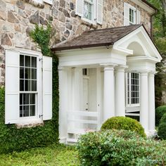 White front entry with columns. D. Stanley Dixon Architect
