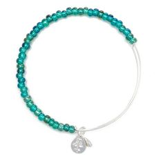 Add any Sea Bead Bangle to your bangle set to add a pop of color for an entire new look. Designed to wear alone or to layer for a customized look, Alex and Ani's patented Expandable Wire Bangle is the most innovative concept in jewelry, allowing the wear