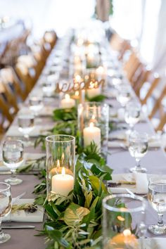 Sunset Cove Wedding / Parsonage Events / green garland table runner  / hurricane lamps