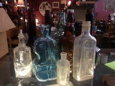 Vintage liquor bottles, great for crafts or decoration!