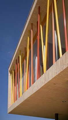 Colored wood poles are literal interpretation of growing bamboo. Notice the brick and the interplay of colors: red, yellow, orange. Credit Colegio Los Nogales / Daniel Bonilla Arquitectos Archdaily.com
