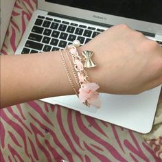 Pink chain gold bow armcandy bracelet Really cute pale pink arm candy. Goldchain infused with pale pink cloth with pearl and bow charm Accessories