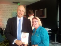 Trish and Ian Field winner of a copy of Trischel's book at Opportune Networking Meeting