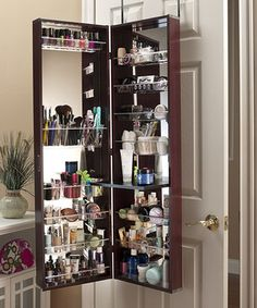 Neatly and easily store cosmetics, nail polish and more with this handsome armoire. It opens to reveal special compartments that are easily removed for washing, plus features a drop-down table that keeps necessities in easy reach while applying makeup.