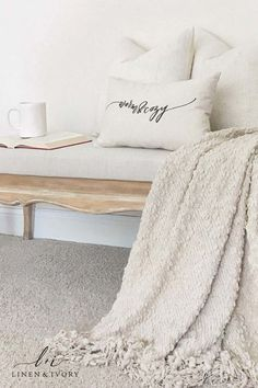 Cozy Entryway Decor: Neutral & Minimalist This gorgeous entryway nook of neutral blankets, pillows, and bench features our Warm & Cozy pillow. A great spot to tak. Farmhouse Kitchen Interior, Farmhouse Style Bedrooms, Farmhouse Bedroom Decor, Farmhouse Design, Modern Farmhouse, Hallway Decorating, Entryway Decor, Entryway Ideas, Decorating Ideas