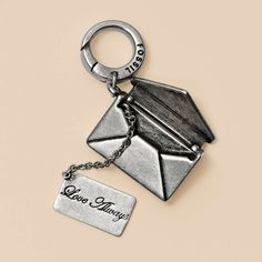 pendant/charm of an envelope that actually opens and has a letter inside!!!