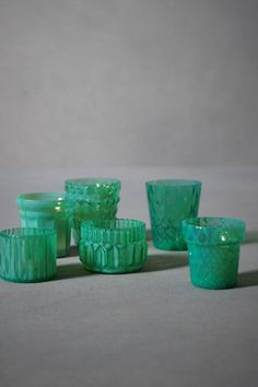 Votive candle holders, green glass