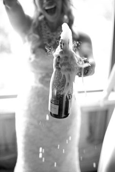 I love this picture of this carefree bride! You know you're having a great time on your wedding day when you pop some champagne all over yourself! :)