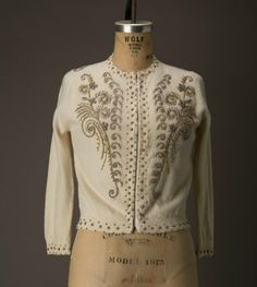 Vintage cream colored sweater with beading.