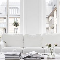 white sofa, white walls