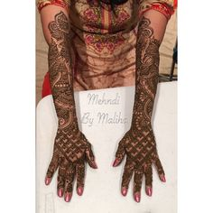 Traditional Indian bridal mehndi to the elbow