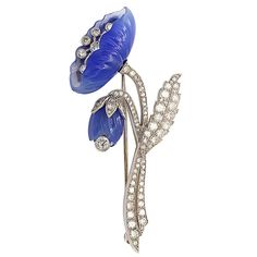 Chalcedony and diamond floral brooch mounted in platinum, American, c. 1920's. art deco