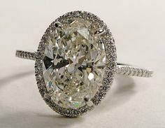 halo set, oval diamond. vintage feel, love the slight sepia tint.....reminds me of Twilight! <3