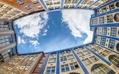 Download wallpapers Berlin, blue sky, bottom view, white clouds, old houses, Germany