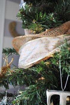 wrap ribbon and burlap around your tree for a rustic, glam feel!