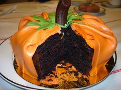Pumpkin Chocolate Ganache Cake..... I already make a great pumpkin cake from a bunds pan but this is interesting!
