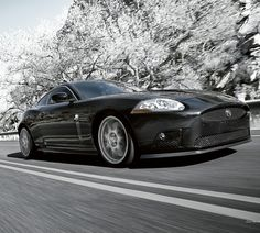 Jaguar XKR.  One day Rodney ...