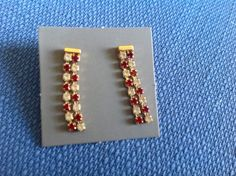 Pair of Vintage New in Box Avon Goldtone Simulated Ruby and Rhinestone Pierced Earrings with Surgical Steel Posts on Etsy, $8.95