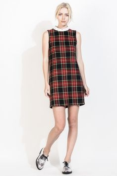 This plaid printed dress is perfect for the preppy school look for the fall! Wear with a knit cardigan, tights, and oxfords for colder weather, or go for a grunge vibe with a leather jacket and black boots.