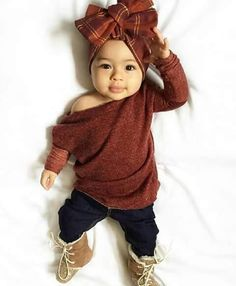 Baby girl:  Burgandy Sweater with a head wrap. Aww she's so cute.