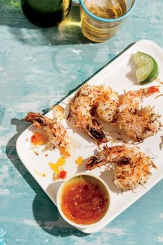 Baked Coconut Shrimp 20 large shrimp, peeled and deveined 1/3 cup panko bread crumbs 1/3 cup unsweetened coconut flakes 1/8 tsp cayenne pepper 1/8 tsp chili powder 2 Tbsp flour 1 egg white, beaten 2 Tbsp sweet chili sauce 2 Tbsp pineapple or mango jam or preserves