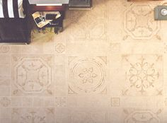 """Renaissance porcelain floor tile in the Navona color with 24"""" x 24"""" and 6"""" x 6"""" decorative accents."""