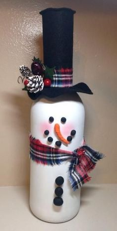 Wine bottle snowman - What a cute idea?! Great inspiration for your next craft night! by Michele Yancey O'Hara