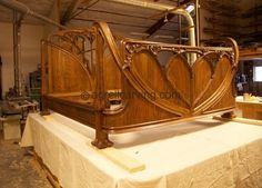Wood carved California king sized bed inspired by the Louis Marjorelle original. - by Agrell Architectural Carving.