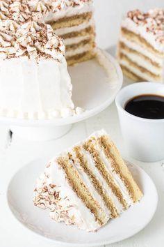 Layer Cake + Video TIRAMISU LAYER CAKE (with Eggless Tiramisu Cream) - an effortlessly elegant and impressive dessert for all occasions.TIRAMISU LAYER CAKE (with Eggless Tiramisu Cream) - an effortlessly elegant and impressive dessert for all occasions. Just Desserts, Delicious Desserts, Dessert Recipes, Yummy Food, Italian Desserts, Italian Cake, Baking Desserts, Cupcakes, Cupcake Cakes